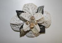 Flower pin made of Alligator scales